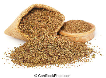 Ajwain seeds in sack and a wooden bowl