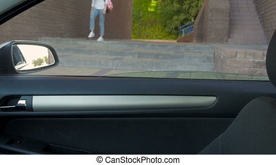 Young Beautiful College Student Girl Getting In Car After...