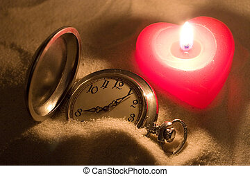 Time and Love - Antique watch covered with sand and a red...