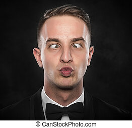 Silly businessman with funny face - Portrait of a young...