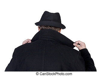 Mysterious man wearing a black hat and a black coat with a...