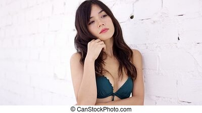 Beautiful woman in green bra and hand in pocket - Single...