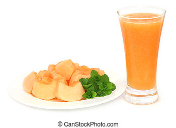 Juice of cucumis melo or muskmelon in a glass with sliced...