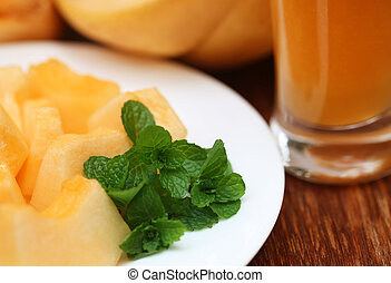 Juice of cucumis melo or muskmelon with green mint leaves