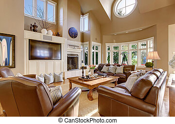 Large living room interior design with high vaulted ceiling...