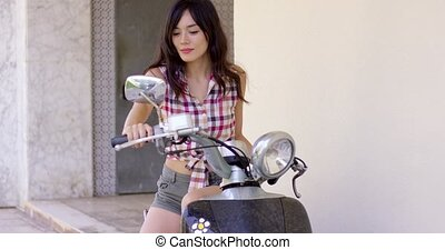 Attractive young woman on a motorcycle - Attractive young...