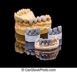 Set of dentures. False teeth on black background