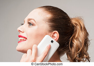 smily girl on the phone - beautiful smily girl on the phone