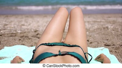 Body view of a young woman sunbathing - Low angle body view...