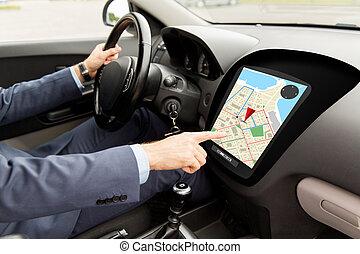 close up of man driving car with gps navigator map -...