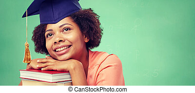 happy african bachelor girl with books at school -...