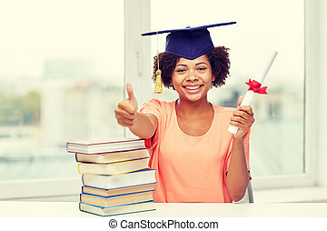 happy african bachelor girl with books and diploma -...