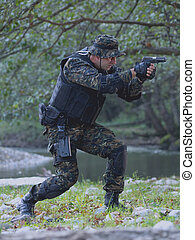 Police special forces, under exposed photo.National flag on...