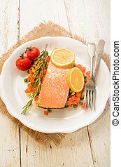 steamed salmon fillet on finely chopped vegetable, tomato...