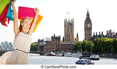 woman with shopping bags over london city - people,...