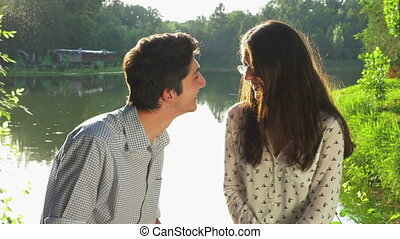 Young loving couple chatting in the park