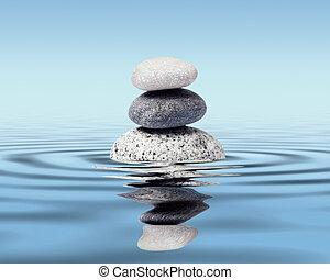 Zen stones balance concept - Zen stones in water with...