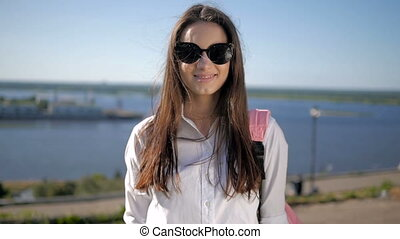 Young Sexy Girl Outdoor Fashion Portrait. Beautiful Stylish Female Skateboarder Wears Sunglasses In Park