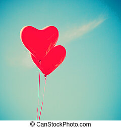 Red heart shaped balloons
