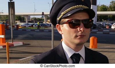 the pilot goes to the airport at summer evening