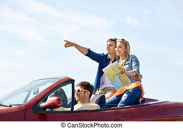 happy friends driving in cabriolet car - leisure, road trip,...
