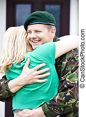 Soldier Visiting Home On Leave Hugging Wife