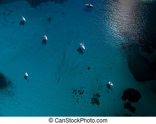 Aerial view of boats in a splendid cove in Corsica