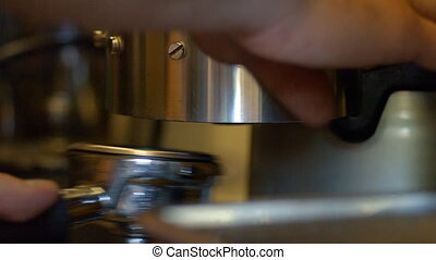 Barista making coffee - Barista Tamping Fresh Ground Coffee
