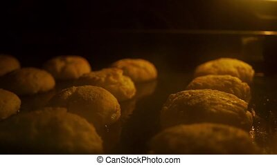 Baking buns in an oven shallow focus video - Baking buns in...