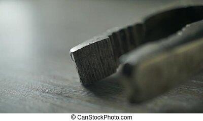 Old used pliers macro video - Old used pliers macro shot
