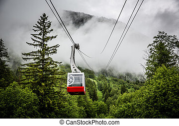 Cable car in the mountains with fog