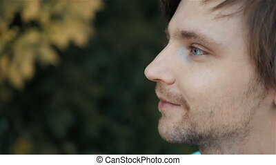 Highly Detailed Close-Up Side View Portrait of Handsome Man With Beautiful Blue Eyes, Outdoor