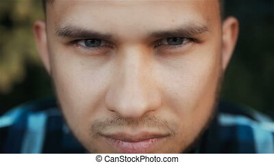 Close Up Portrait of Young Angry Man, Outdoors, Slow Motion,...