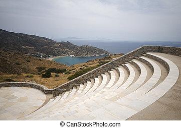 modern amphitheater overlooking the Aegean Sea and Milopotas...