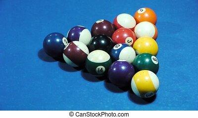 Pool balls separating during break