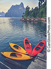 Kayak on Cheo Lan lake. Khao Sok National Park. Thailand....