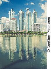 Highrise modern building in Bangkok, Thailand. (Vintage filter effect used)
