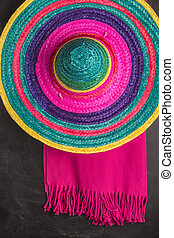 Mexican background with sombrero and blankets