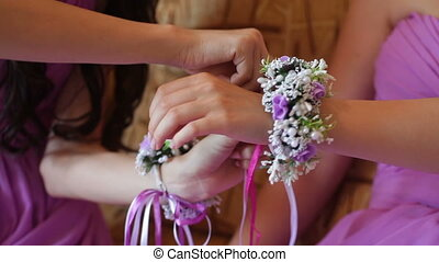 Bridesmaids knotted buttonhole on hand