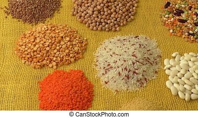 Various colorful dried legumes on a yellow background