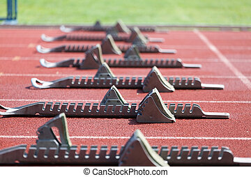 Athletics starting blocks. - Athletic track. Athletics...