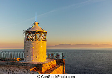 Sunset over Lighthouse in Kavala, East Macedonia and Thrace,...