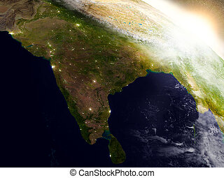 India from space during sunrise - India region from Earths...