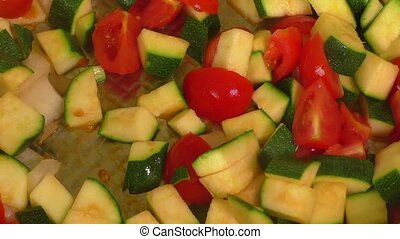 Braised zucchini and other vegetables with spices. Selective...