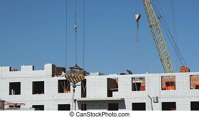 Construction site. The builders put the brickwork - The...