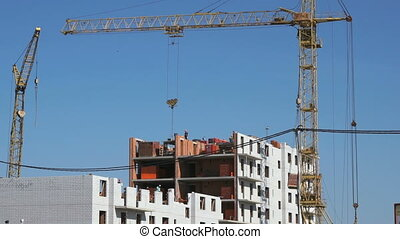 Builders put the brickwork. The construction site - The...