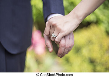 Close Up Holding Hands with Engagement Ring - Engaged male...