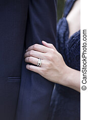 Close Up Holding Hands with Engagement Ring