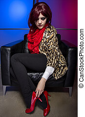 Model In a Nightclub with Red Shoes - Young fashionable...
