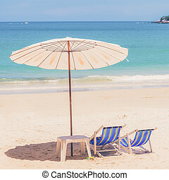 Beach chair and Umbrella on the beach at Samed...